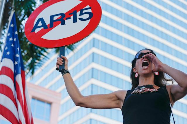 "<p>Alessandra Mondolfi holds a sign against AR-15 weapons as she yells, ""No More"" during a protest against guns on the steps of the Broward County Federal courthouse in Fort Lauderdale, Fla., on Saturday, Feb. 17, 2018. (Photo: Brynn Anderson/AP) </p>"