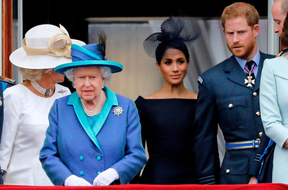 <p>Royal family on  the Buckingham Palace balcony watching a military fly-past to mark the centenary of the Royal Air Force.</p> (AFP via Getty Images)
