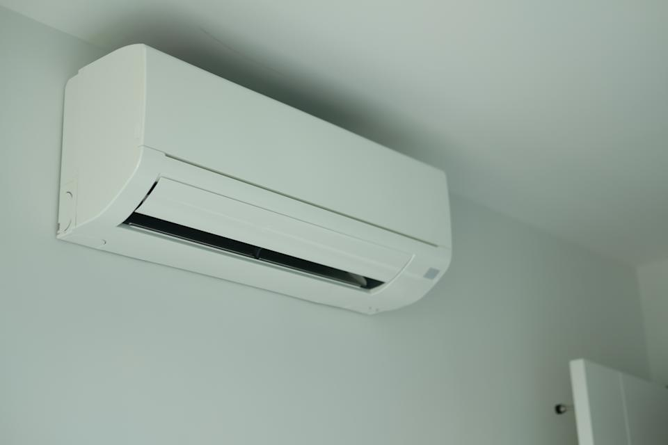 Air conditioner inside the room on white wall background