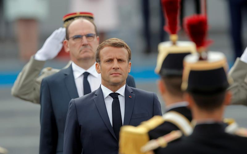 France's President Emmanuel Macron and France's Prime Minister Jean Castex review troops - REUTERS