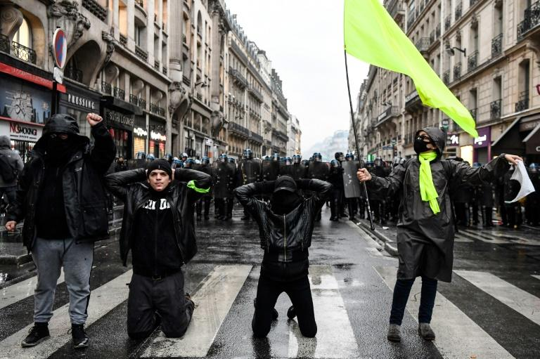 Police said at least 24 people had been detained in Paris, where 56,000 people marched toward the Saint-Lazare train station (AFP Photo/Bertrand GUAY)