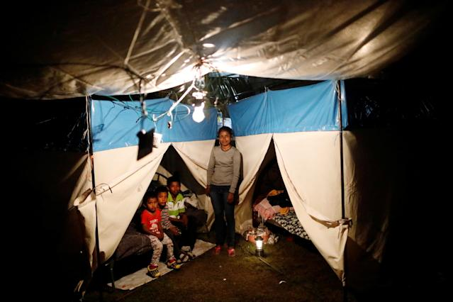 "<p>Veronica Dircio, 34, a housewife, poses for a portrait with her sons in front of a tent in a neighbour's backyard after an earthquake in San Juan Pilcaya, at the epicentre zone, Mexico, September 28, 2017. Dircio's house was badly damaged. ""We stayed on the street. We expect the demolition of our house and the help of the authorities,"" she said. (Photo: Edgard Garrido/Reuters) </p>"
