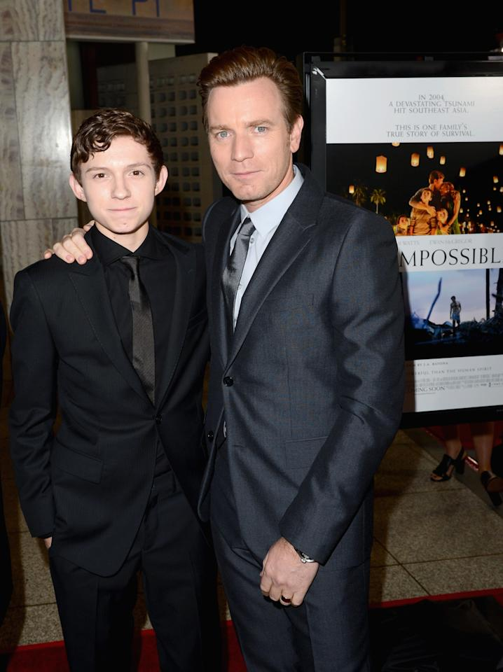 "HOLLYWOOD, CA - DECEMBER 10:  Actors Tom Holland (L) and Ewan McGregor attend the Los Angeles premiere of Summit Entertainment's ""The Impossible"" at ArcLight Cinemas Cinerama Dome on December 10, 2012 in Hollywood, California.  (Photo by Jason Merritt/Getty Images)"