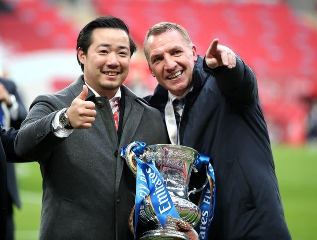 Khun Top (left) and Brendan Rodgers celebrate Leicester's success