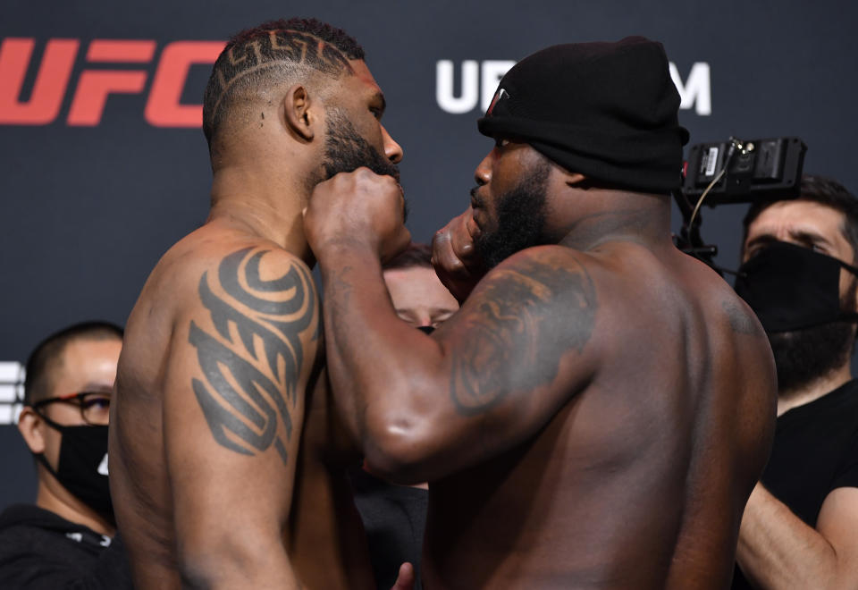 LAS VEGAS, NEVADA - FEBRUARY 19: (L-R) Opponents Curtis Blaydes and Derrick Lewis face off during the UFC weigh-in at UFC APEX on February 19, 2021 in Las Vegas, Nevada. (Photo by Chris Unger/Zuffa LLC)