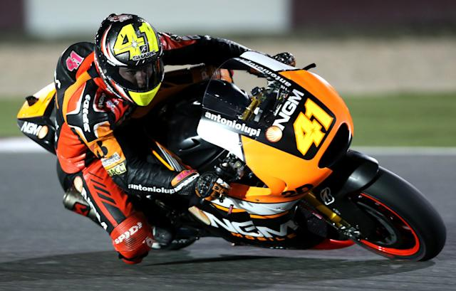 NGM Mobile Forward Racing MotoGP rider Aleix Espargaro of Spain races during a free practice session at the MotoGP World Championship at the Losail International circuit in Doha March 21, 2014. REUTERS/Fadi Al-Assaad (QATAR - Tags: SPORT MOTORSPORT)