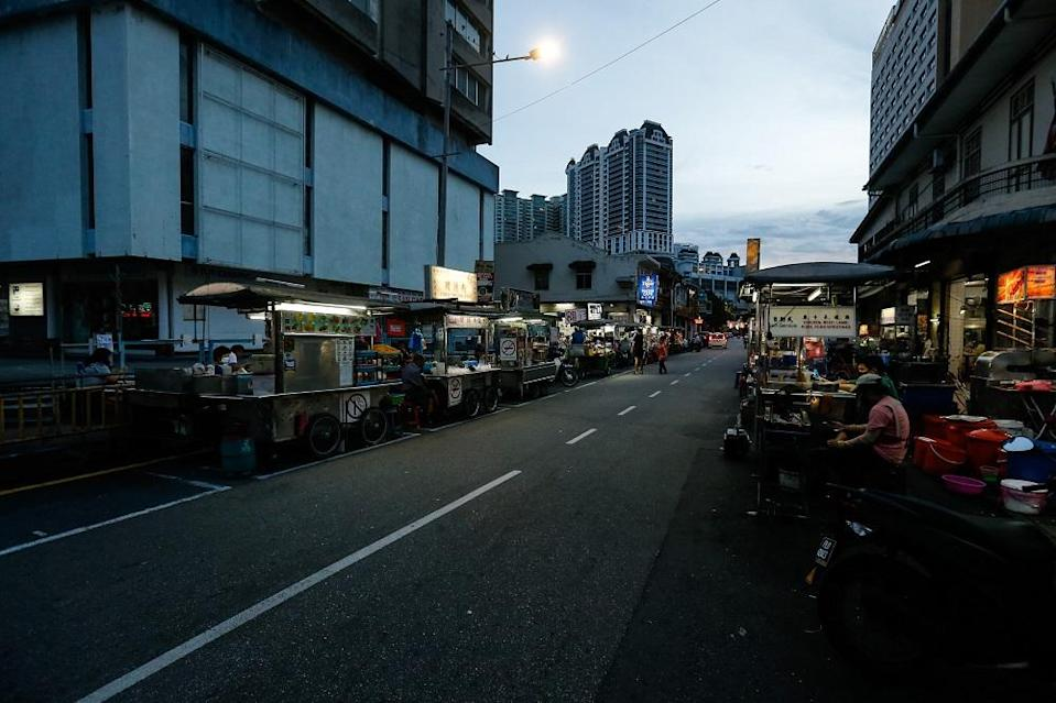 Almost half of the 28 hawker stalls that lined the narrow street have opted to close their stalls since the four-week CMCO was imposed on November 9 at New Lane.