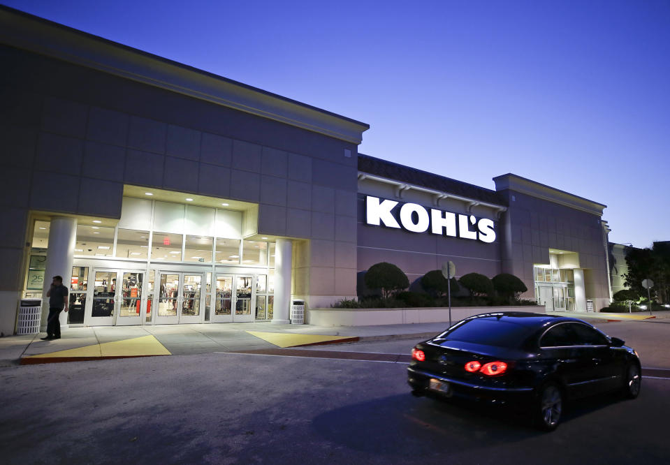 FILE - In this Aug. 22, 2017, file photo, a car drives by the entrance of a Kohl's department store in Orlando, Fla. Kohl's Corp. delivered a better assessment of fiscal fourth-quarter earnings, but a key sales measure was down more than analysts expected. Online sales growth rose more than 20%, and accounted for more than 40% of net sales during the period, Kohl said. (AP Photo/John Raoux, File)