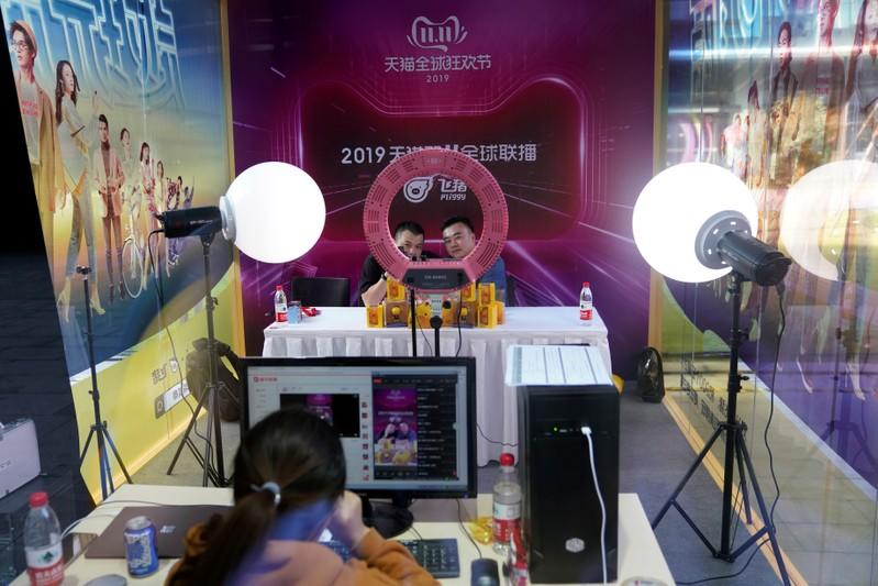 Two merchants perform in a live stream booth during Alibaba Group's 11.11 Singles' Day global shopping festival at the company's headquarters in Hangzhou