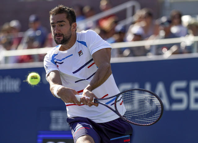 Marin Cilic, of Croatia, returns a shot to John Isner, of the United States, during round three of the US Open tennis championships Saturday, Aug. 31, 2019, in New York. (AP Photo/Michael Owens)
