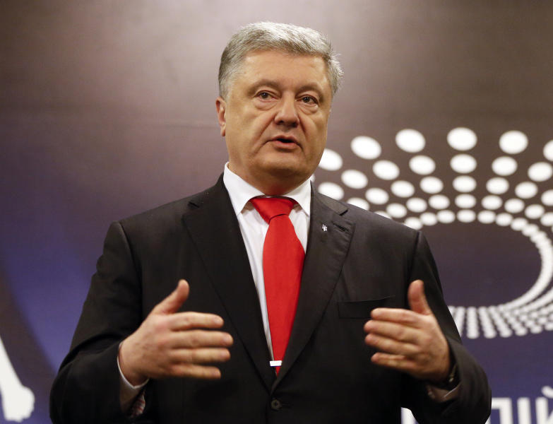 Ukraine's President Petro Poroshenko speaks to the media after he past medical tests taken by experts from the Voluntary Anti-Doping Association (VADA) ahead of a runoff vote, at Kiev Olimpiyskiy Stadium, in Kiev, Ukraine, Wednesday, April 10, 2019. TV sitcom actor and comedian Volodymyr Zelenskiy will contend the second round run-off vote on April 21, against incumbent President Petro Poroshenko. (AP Photo/Efrem Lukatsky)