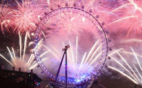 <span>Fireworks light up the sky over the London Eye in central London during the New Year celebrations</span> <span>Credit: PA </span>
