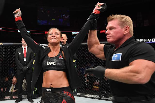 Ashley Yoder celebrates her victory over Syuri Kondo of Japan in their women's strawweight bout during the UFC Fight Night event at Bon Secours Wellness Arena on June 22, 2019 in Greenville, South Carolina. (Getty Images)