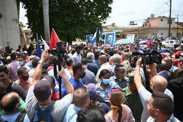 Cuban President Miguel Diaz-Canel (C) is seen during a demonstration held by citizens to demand improvements in the country, in San Antonio de los Banos, Cuba, on July 11, 2021. - Thousands of Cubans marched this Sunday, July 11, through the streets of the small town of San Antonio de los Banos in an unprecedented protest against the government, according to videos of fans posted on the internet. (Photo by Yamil LAGE / AFP) (Photo by YAMIL LAGE/AFP via Getty Images) (Photo: YAMIL LAGE via Getty Images)