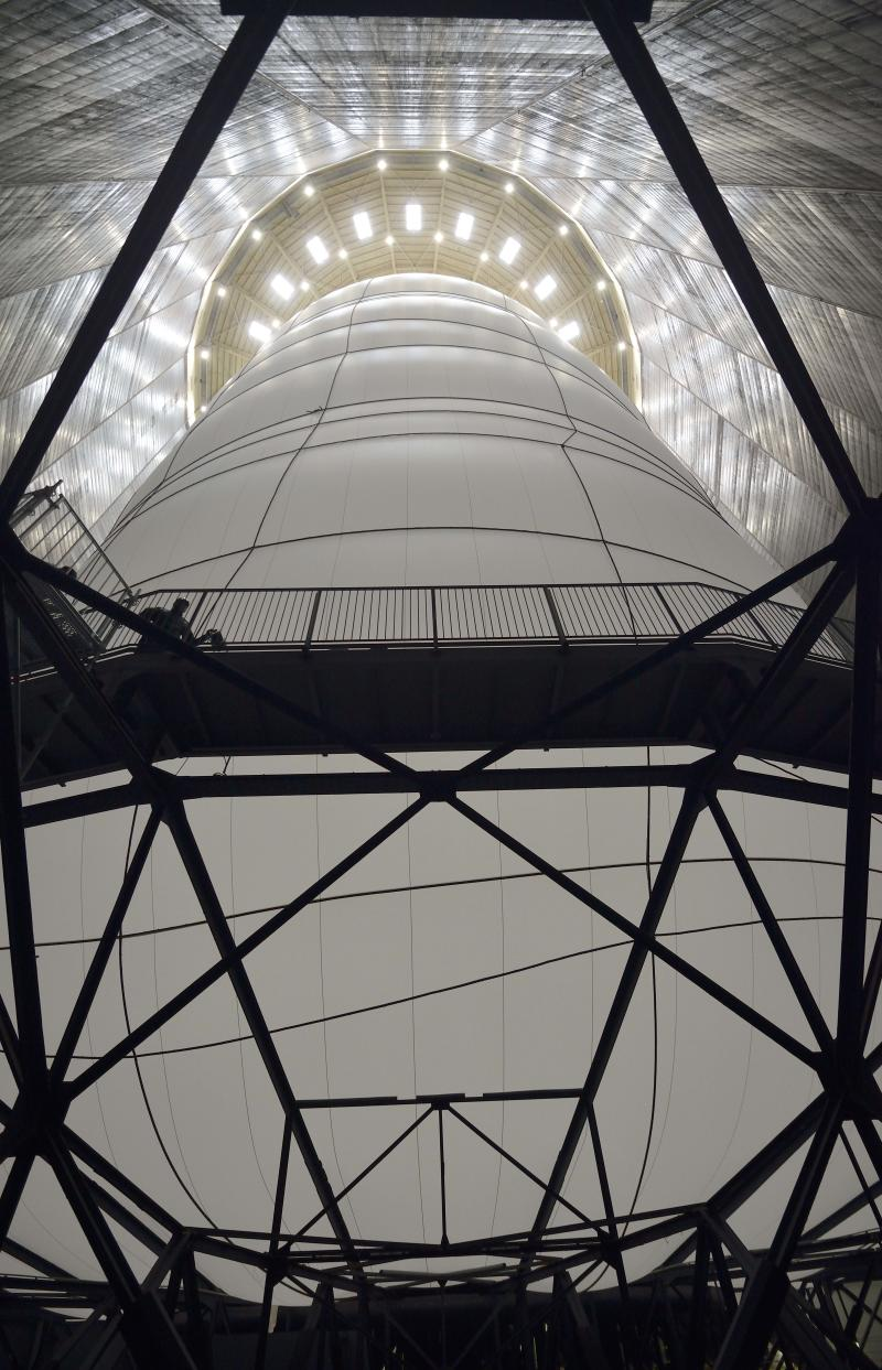In this picture taken March 13, 2013 the 'Big Air Package' artwork by international artist Christo is seen at the Gasometer in Oberhausen, Germany, two days before the opening of the exhibition on March 15. Christo's latest monumental sculpture in the interior of the industrial monument reaches a height of more than 90 metres, a diameter of 50 metres and a volume of 177,000 cubic metres. The world's largest self-supporting sculpture will be on show to the public from March 16 until Dec. 30, 2013. (AP Photo/Martin Meissner)