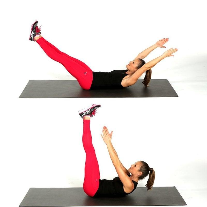<ul> <li>Lie on your back, and lift your legs and arms up so they are extended toward the ceiling. Lift your upper back off the floor, reaching your hands toward your feet.</li> <li>Lower your legs toward the floor while reaching your arms overhead, keeping your shoulders off the mat and lower back pressed into the mat.</li> <li>Repeat the crunch motion to complete one rep.</li> <li>Perform 20 reps.</li> </ul>