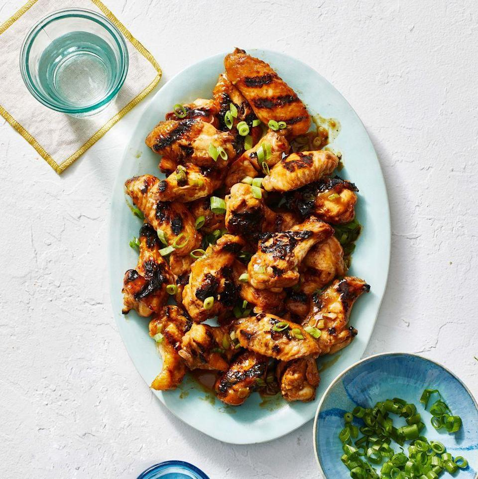 """<p>These chicken wings hit every note: sweet, saucy, smoky, and just a little spicy.</p><p><em><a href=""""https://www.goodhousekeeping.com/food-recipes/a31914016/grilled-chicken-wings-recipe/"""" rel=""""nofollow noopener"""" target=""""_blank"""" data-ylk=""""slk:Get the recipe for Apricot Whiskey Chicken Wings »"""" class=""""link rapid-noclick-resp"""">Get the recipe for Apricot Whiskey Chicken Wings »</a></em></p><p><strong>RELATED: </strong><a href=""""https://www.goodhousekeeping.com/food-recipes/g4992/chicken-wings-recipes/"""" rel=""""nofollow noopener"""" target=""""_blank"""" data-ylk=""""slk:36 Easy Chicken Wing Recipes to Make for Super Bowl Sunday"""" class=""""link rapid-noclick-resp"""">36 Easy Chicken Wing Recipes to Make for Super Bowl Sunday</a></p>"""