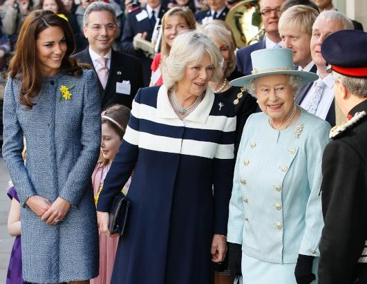 Britain's Queen Elizabeth II, Camilla, Duchess of Cornwall, center, and Kate Middleton, Duchess of Cambridge, stand outside the Fortnum and Mason department store for a ceremony to unveil a plaque to commemorate the regeneration of Piccadilly in central London, March, 1, 2012