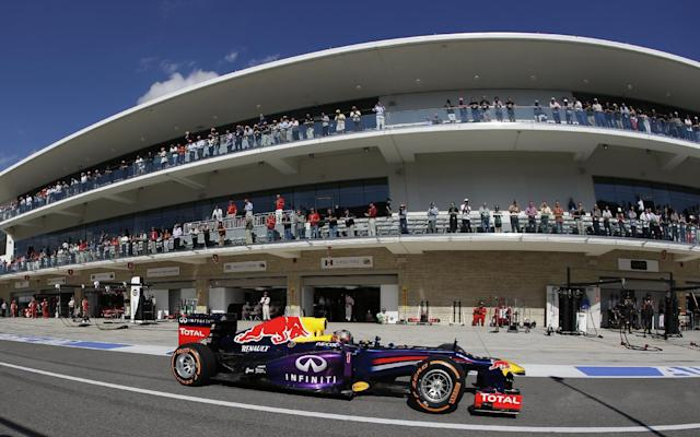 Red Bull driver Sebastian Vettel of Germany drives through the pits after a stop during the Formula One U.S. Grand Prix auto race at the Circuit of the Americas, Sunday, Nov. 17, 2013, in Austin, Texas. (AP Photo/Darron Cummings)
