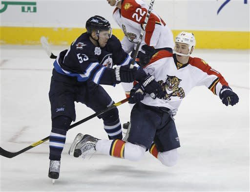 Winnipeg Jets' Brett Festerling (53) collides with Florida Panthers' Shawn Matthias (18) during the second period of NHL hockey game action in Winnipeg, Manitoba, Thursday, Nov. 10, 2011. (AP Photo/The Canadian Press, Trevor Hagan)