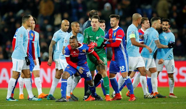 Soccer Football - Champions League - Basel vs Manchester City - St. Jakob-Park, Basel, Switzerland - February 13, 2018 Basel's Serey Die reacts as Manchester City's Ilkay Gundogan (R) looks on REUTERS/Denis Balibouse