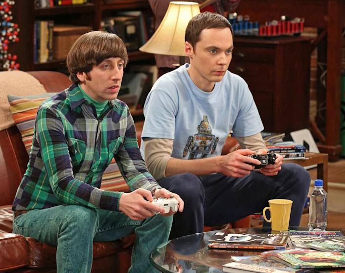 """This image released by CBS shows Jim Parsons, right, and Simon Helberg in a scene from """"The Big Bang Theory."""" Parsons was nominated for an Emmy Award for best actor in a comedy series on, Thursday July 18, 2013. The Academy of Television Arts & Sciences' Emmy ceremony will be hosted by Neil Patrick Harris. It will air Sept. 22 on CBS. (AP Photo/CBS, Michael Yarish)"""