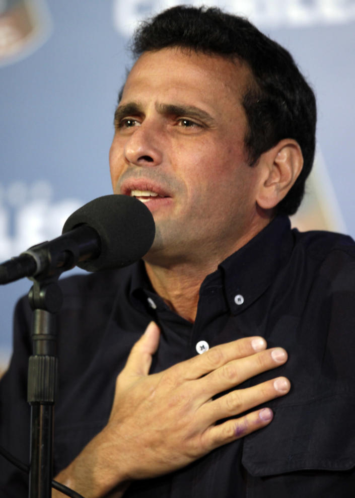 Opposition leader Henrique Capriles gestures during a press conference in Caracas, Venezuela, late Thursday, April 18, 2013. Venezuela's electoral council said Thursday it would audit the 46 percent vote that was not scrutinized election night. Capriles had demanded a full vote-by-vote recount, and has maintained that Sunday's election, which the National Electoral Council had declared won by Hugo Chavez's heir Nicolas Maduro by 262,00000 votes out of 14.9 million cast, was stolen from him through intimidation and other abuses.(AP Photo/Ariana Cubillos)