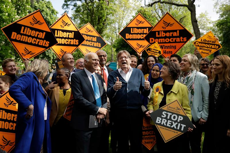 Running for re-election as an MEP, European Parliament Brexit chief Guy Verhofstadt, center, who is the leader of the Alliance of Liberals and Democrats for Europe, speaks as he stands with the leader of the British Liberal Democrats party Vince Cable, center left, as they pose for the media with supporters in Camden Square, London, Friday, May 10, 2019. Verhofstadt on Friday joined British Liberal Democrats who were going to canvas residents in the area. (AP Photo/Matt Dunham)