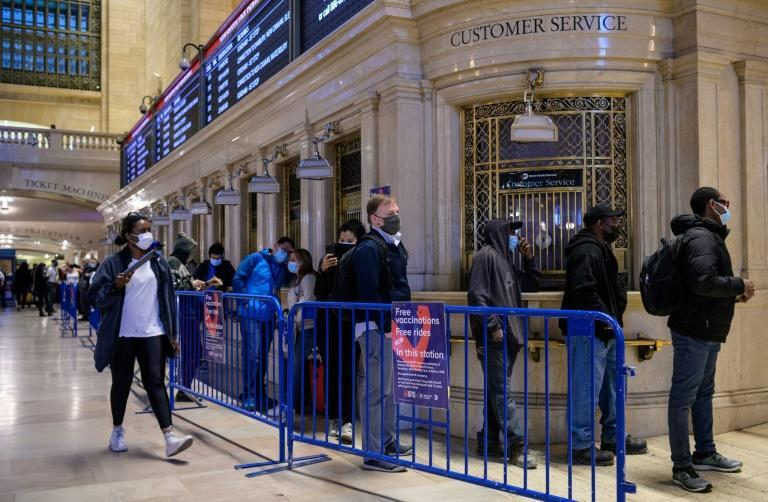 People stand in line to receive the Covid-19 vaccine at a temporary vaccination site at Grand Central Terminal on May 12, 2021, in New York City
