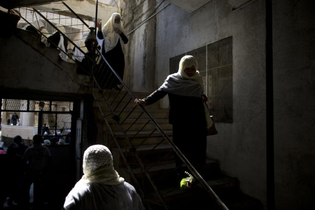 <p>Druse women walk down the stairs during a rally demanding the return of the Golan Heights, captured by Israel in 1967, close to the Syrian border in Majdal Shams in the Golan Heights, Feb. 14, 2014. (Photo: Oded Balilty/AP) </p>