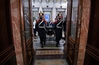 This handout picture released by the Argentine Senate shows the coffin of former Argentine president Carlos Menem, arriving at the Congress in Buenos Aires, to lie in state