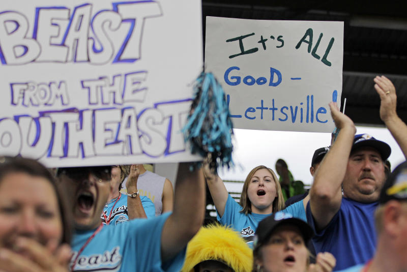 Family and fans of the Goodlettsville, Tenn. Little League team cheer at the end of a 9-6 win over Petaluma, Calif. in a baseball game during Little League World Series pool play in South Williamsport, Pa., Sunday, Aug. 19, 2012. (AP Photo/Gene J. Puskar)