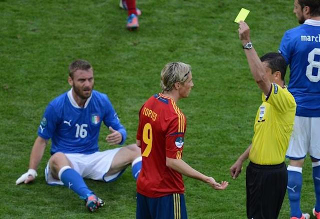 Spanish forward Fernando Torres (C) is shown a yellow card by referee during the Euro 2012 championships football match Spain vs Italy on June 10, 2012 at the Gdansk Arena. The game ended in a draw 1-1. AFPPHOTO/ PATRIK STOLLARZPATRIK STOLLARZ/AFP/GettyImages