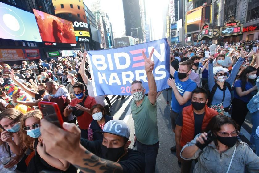 New York, New York-Nov. 7, 2020- Thousand show up for a part in the streets at Times Square to celebrate President-elect Joe Biden and Vice President Kamala Harris in Times Square New York, New York, on Nov. 7, 2020. (Kirk McKoy / Los Angeles Times)