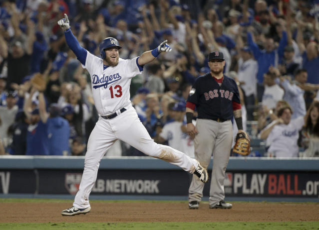 Los Angeles Dodgers' Max Muncy celebrates after his walk off home run against the Boston Red Sox during the 18th inning in Game 3 of the World Series baseball game on Saturday, Oct. 27, 2018, in Los Angeles. (AP Photo/Jae C. Hong)