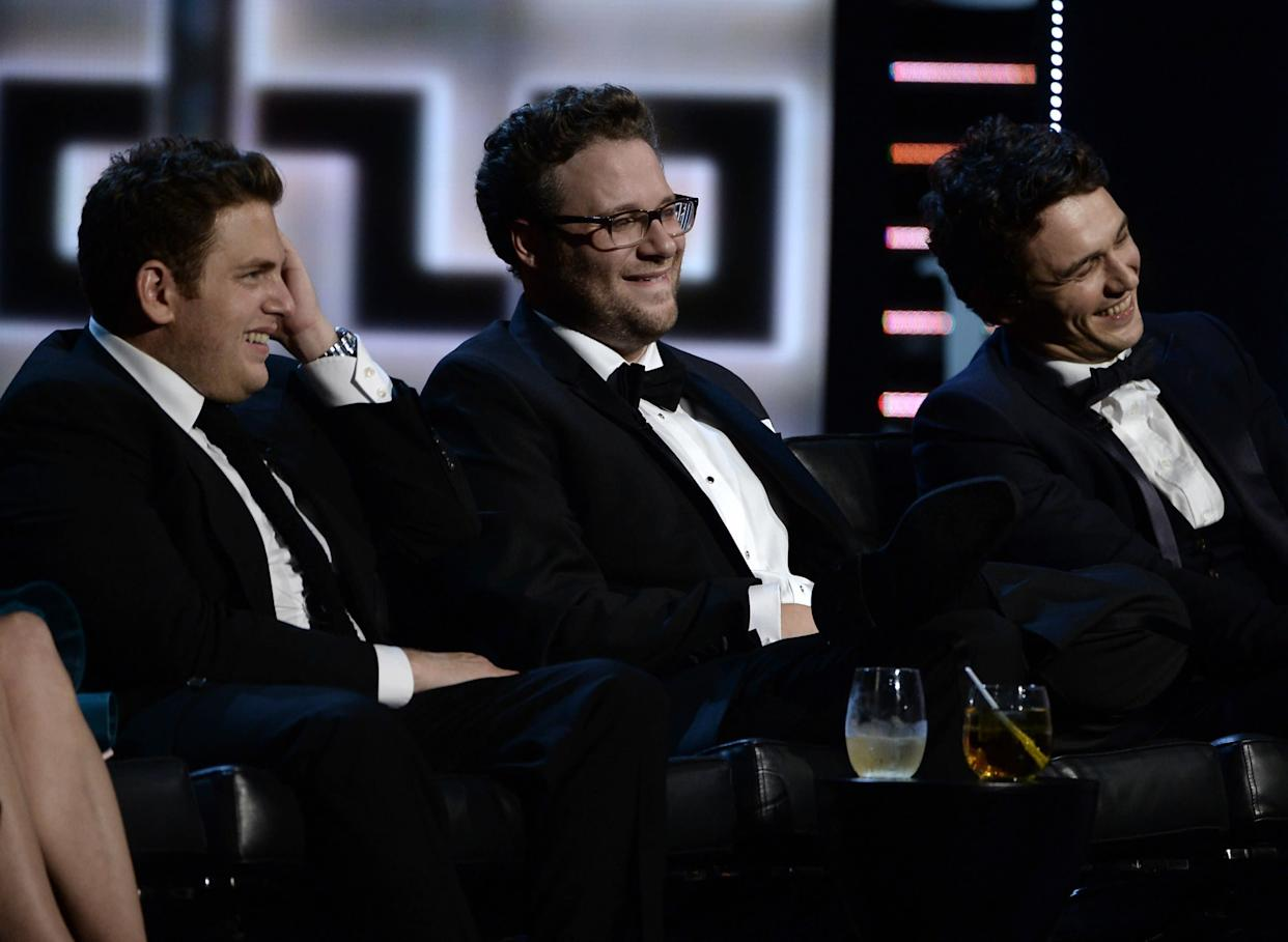 CULVER CITY, CA - AUGUST 25: (L-R) Actor Jonah Hill, roast master Seth Rogen and roastee James Franco onstage during The Comedy Central Roast of James Franco at Culver Studios on August 25, 2013 in Culver City, California. The Comedy Central Roast Of James Franco will air on September 2 at 10:00 p.m. ET/PT. (Photo by Kevin Winter/Getty Images for Comedy Central)