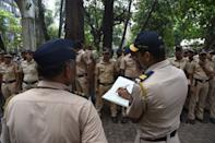 Police officers gather in Mumbai on November 9, 2019, as security was tightened across India for a Supreme Court ruling over a holy site contested for centuries by Hindus and Muslims. - Police were put on alert nationwide ahead of the ruling, with thousands of extra security personnel deployed and schools closed in and around the northern city of Ayodhya, centre of the spat. (Photo by INDRANIL MUKHERJEE / AFP) (Photo by INDRANIL MUKHERJEE/AFP via Getty Images)