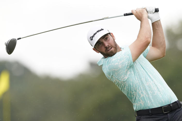 Matthew Wolff watches his drive from the 18th tee box during the third round of the Sanderson Farms Championship golf tournament in Jackson, Miss., Saturday, Oct. 2, 2021. (AP Photo/Rogelio V. Solis)