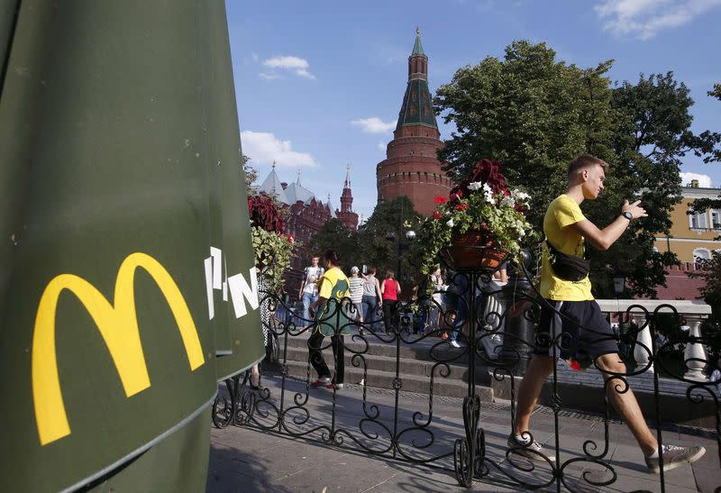 A man walks past a closed McDonald's restaurant, one of four temporarily closed by the state food safety watchdog, in Moscow
