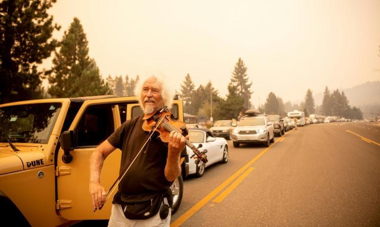 Mel Smothers rescued his violin when he was told he had to leave his home near Lake Tahoe (AFP/JOSH EDELSON)