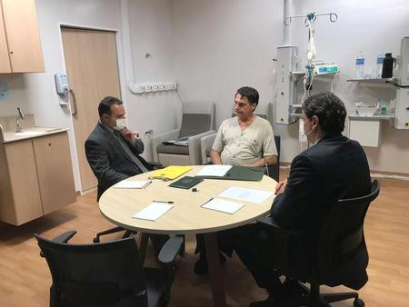 Brazil's President Bolsonaro talks with Infrastructure Minister Freitas and and the Deputy Chief of Legal Affairs of the Civil House of the Presidency of the Republic, Oliveira at Albert Einstein Hospital in Sao Paulo