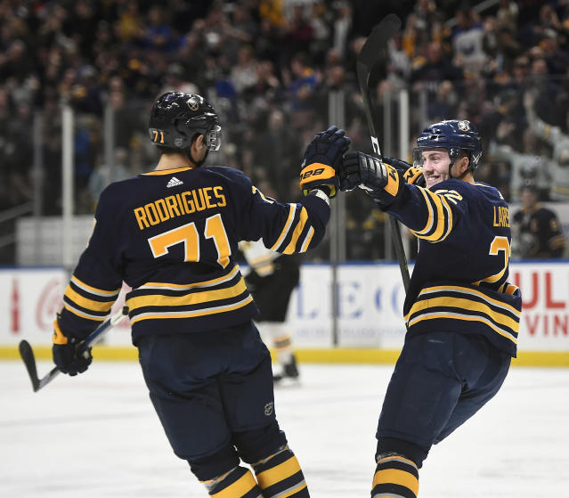 Buffalo Sabres center Johan Larsson, right, celebrates his short-handed goal with left wing Evan Rodrigues during the second period of an NHL hockey game against the Boston Bruins in Buffalo, N.Y., Saturday, Dec. 29, 2018. (AP Photo/Adrian Kraus)