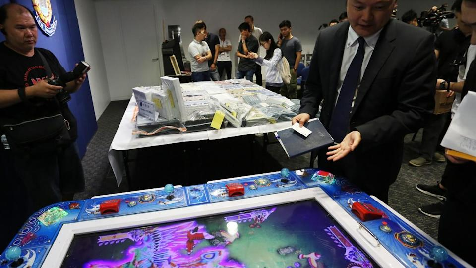 Triad-linked gambling dens in Hong Kong smashed in citywide police operation