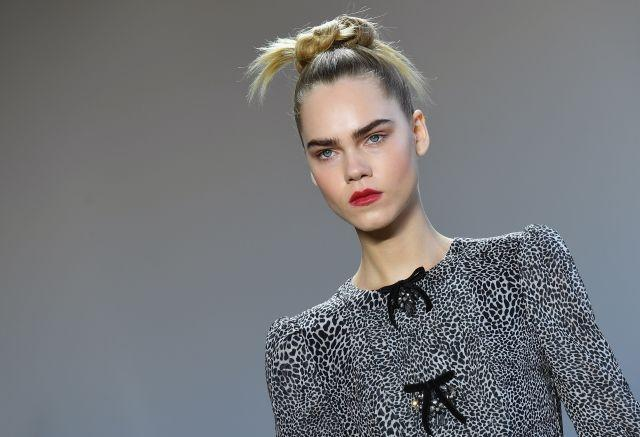 Spiky top knots, bold brows and statement red lipstick kept the Badgley Mischka beauty look on point