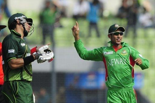 Bangladesh's Nasir Hossain (R) and Pakistan captain Misbah-ul-Haq during the Asia Cup final in March