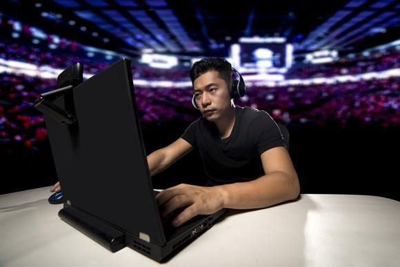 Man playing a video game in a stadium.