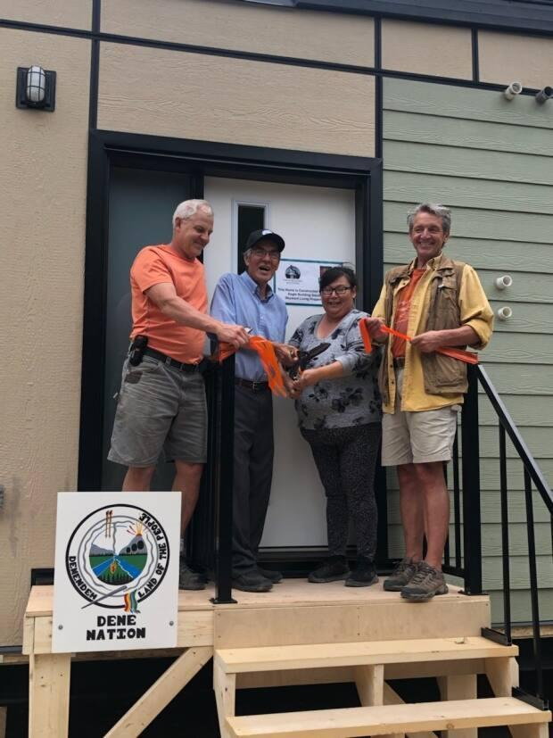 Chief Norman Yakeleya, centre left, welcomes the display of a new modular housing unit on the K'atl'odeeche First Nation reserve in August 2021. He told reporters on Sept. 29 that housing units like these could help get flooding victims in Jean Marie River and Fort Simpson in new homes faster. (Supplied by Dene Nation - image credit)
