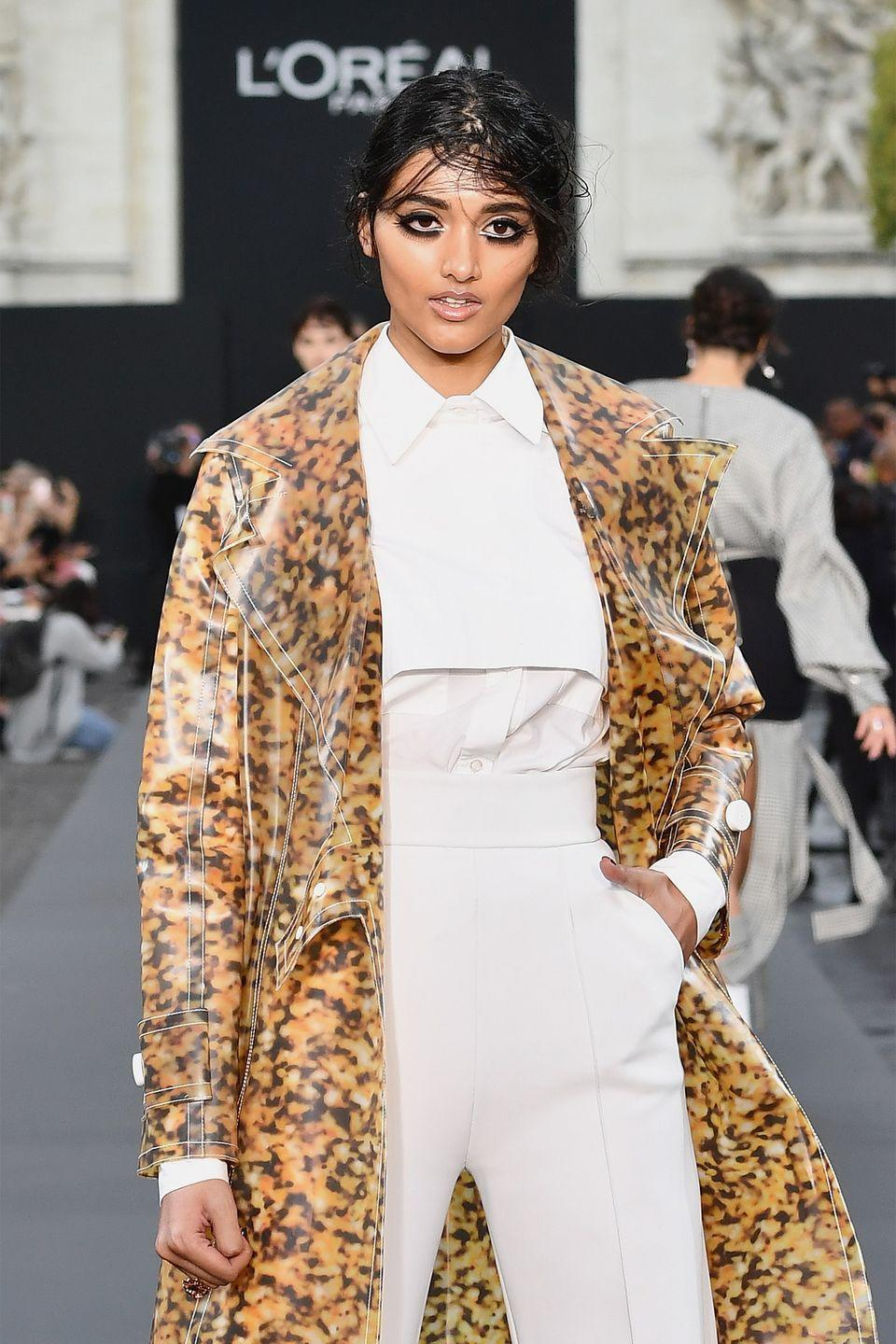 "<p>Although the London native was originally scouted for modeling when she still in high school, Gill officially broke through the industry when she landed a Burberry campaign at just 19 years old. It helped her popularity that this campaign was her first job ever, according to <a href=""https://www.elle.com/fashion/news/a26940/neelam-gill-interview/"" rel=""nofollow noopener"" target=""_blank"" data-ylk=""slk:ELLE"" class=""link rapid-noclick-resp""><em>ELLE</em></a>, and that she became the first Indian model to pose for the fashion house's ads.</p>"