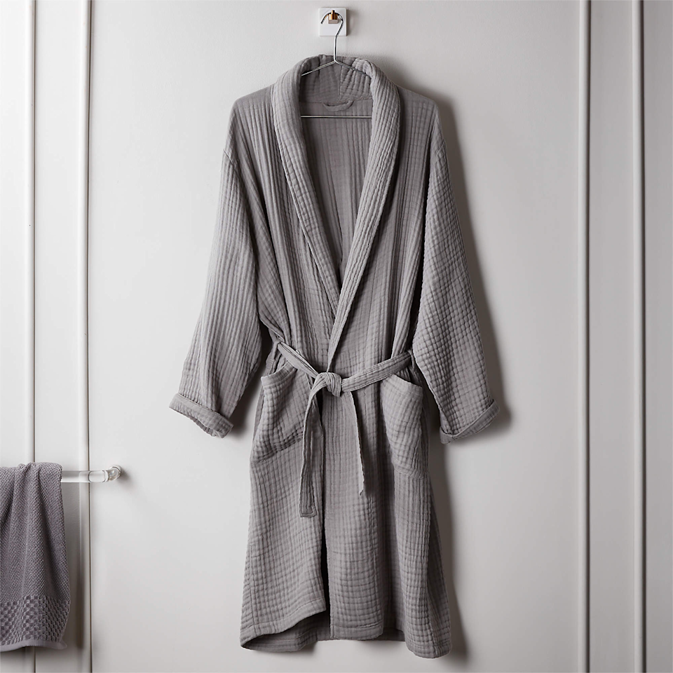 """<h3><h2>CB2 Cotton Gauze Lightweight Bath Robe</h2></h3><br>This light and breathable cotton robe is cool enough for warmer months, but cozy enough for cooler seasons. <br><br><strong>CB2</strong> Cotton Gauze Lightweight Bath Robe, $, available at <a href=""""https://go.skimresources.com/?id=30283X879131&url=https%3A%2F%2Fwww.cb2.com%2Fcotton-gauze-lightweight-grey-bath-robe%2Fs411856"""" rel=""""nofollow noopener"""" target=""""_blank"""" data-ylk=""""slk:CB2"""" class=""""link rapid-noclick-resp"""">CB2</a>"""