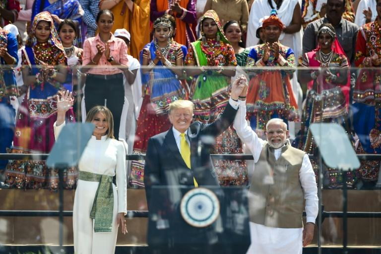 """Trump heaped praise on Modi as """"a great champion of India"""" in front of around 100,000 people at the world's biggest cricket stadium (AFP Photo/Money SHARMA)"""